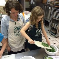 Woman and girl prepping salad
